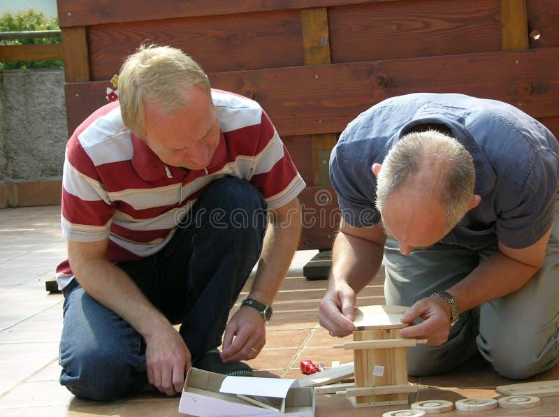 Hombres en el trabajo DIY foto de archivo libre de regalías