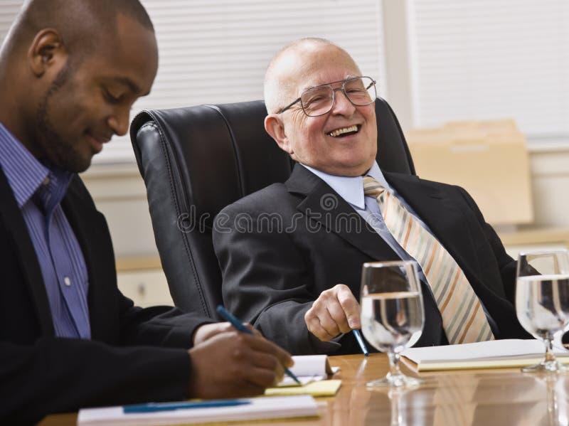 Hombres en la reunión de negocios fotografía de archivo libre de regalías