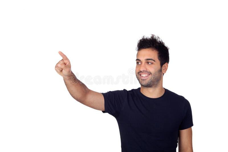 Hombres jovenes atractivos en negro que señalan algo imagenes de archivo