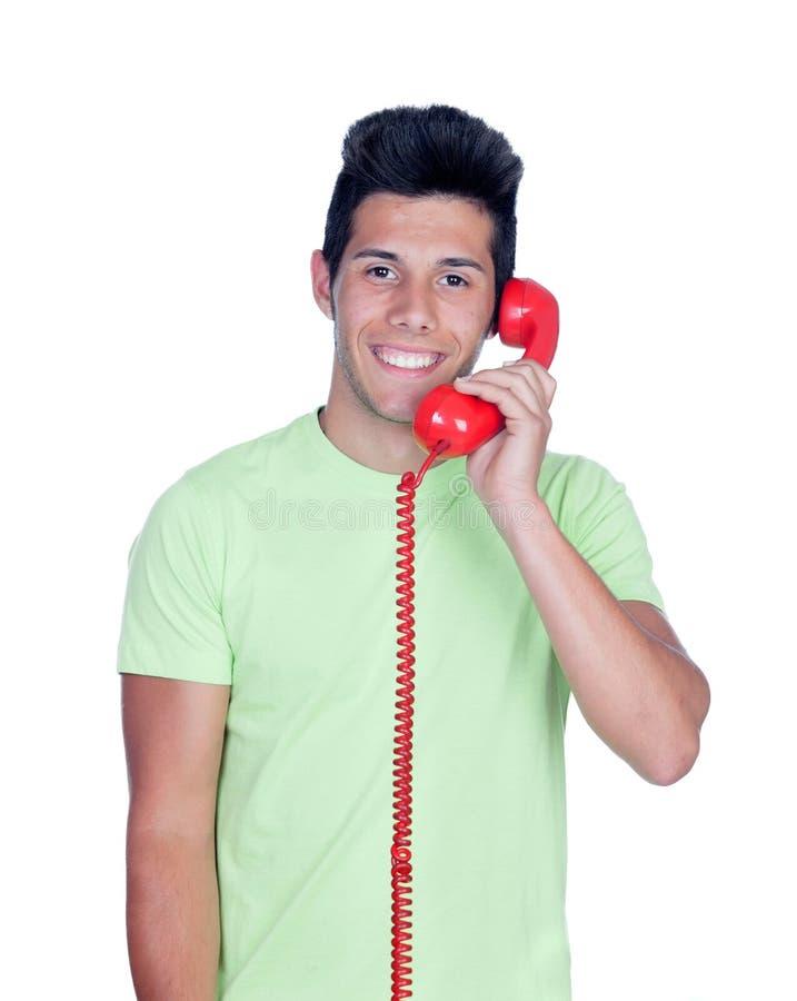Hombres jovenes casuales que llaman por el teléfono imagen de archivo