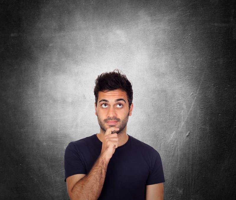 Hombres jovenes pensativos en negro foto de archivo libre de regalías