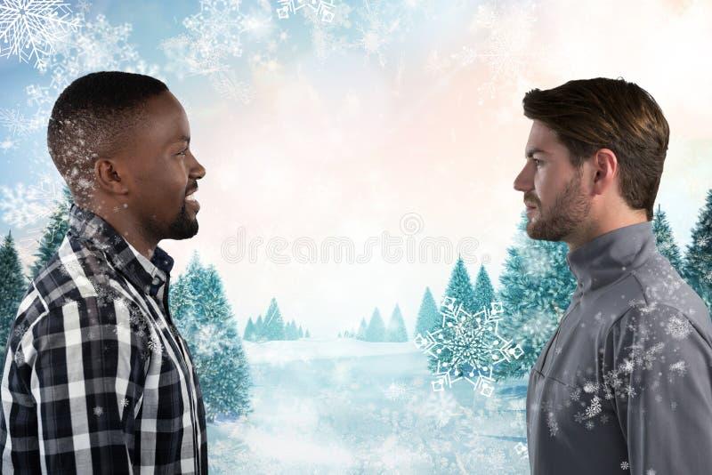 Hombres que miran uno a en tiempo nevoso imágenes de archivo libres de regalías