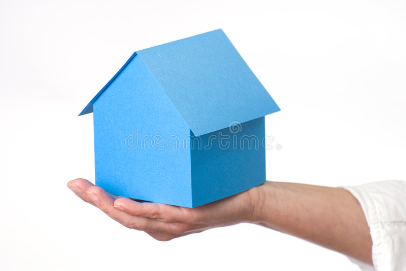 Home. Model on woman's hand royalty free stock image