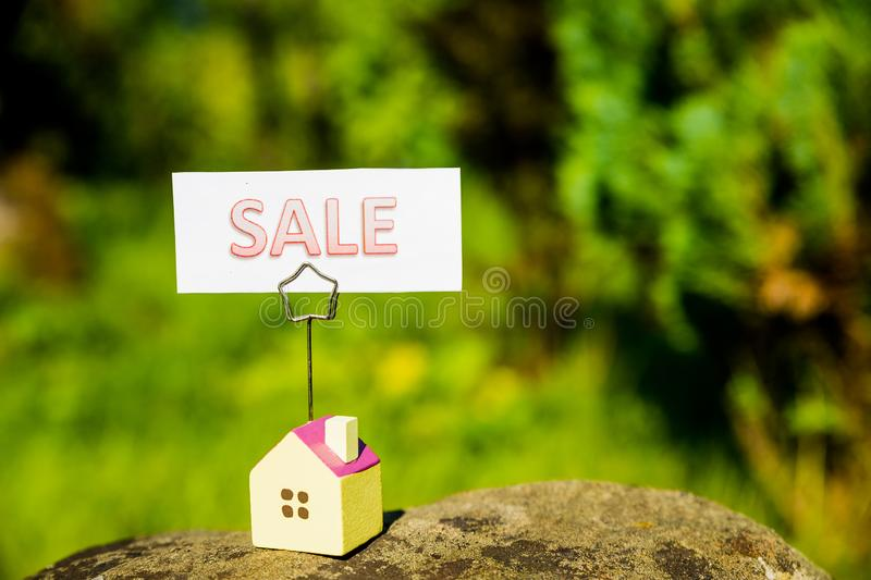 A home is advertising a for sale sign Use it for a housing market concept.Home loan, mortgages, debt, savings money for stock photo
