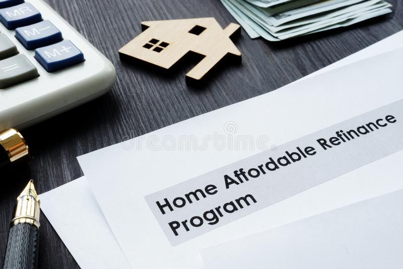 Home Affordable Refinance Program HARP papers. Home Affordable Refinance Program HARP papers on a desk stock photo