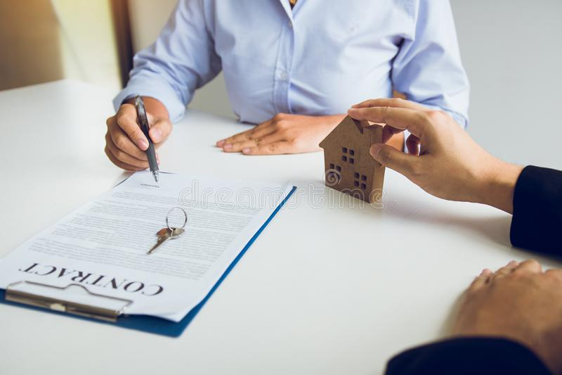 Home agents are sending pens to customers signing a contract to buy a new home.  stock photos