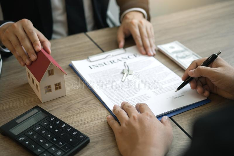 Home agents are sending pens to customers signing a contract to buy a new home.  royalty free stock images