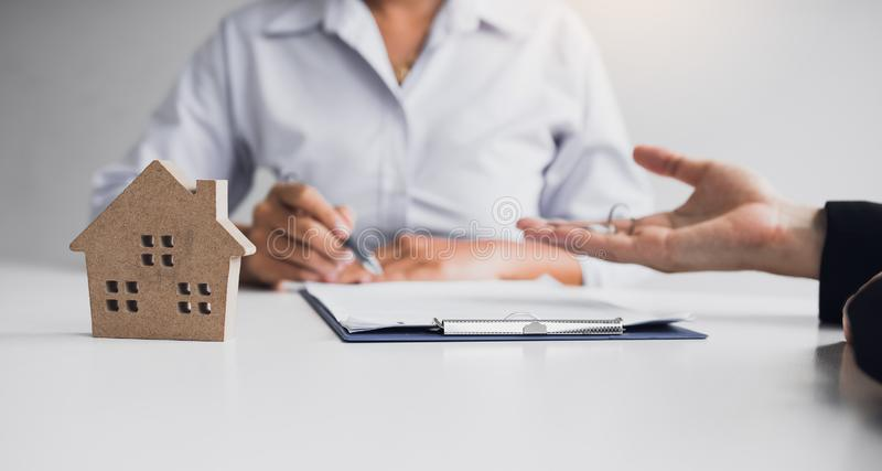 Home agents are sending pens to customers signing a contract to buy a new home.  stock image