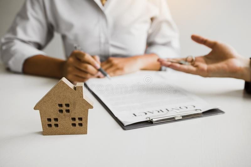 Home agents are sending pens to customers signing a contract to buy a new home.  stock images
