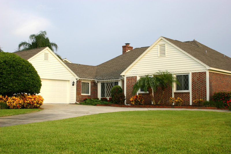 Home - American style. Traditional American style brick home with white trim royalty free stock photos