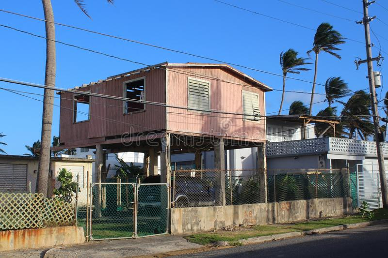 A stilt home shows damage from Hurricanes Irma and Maria in Luquillo Puerto Rico. stock photography