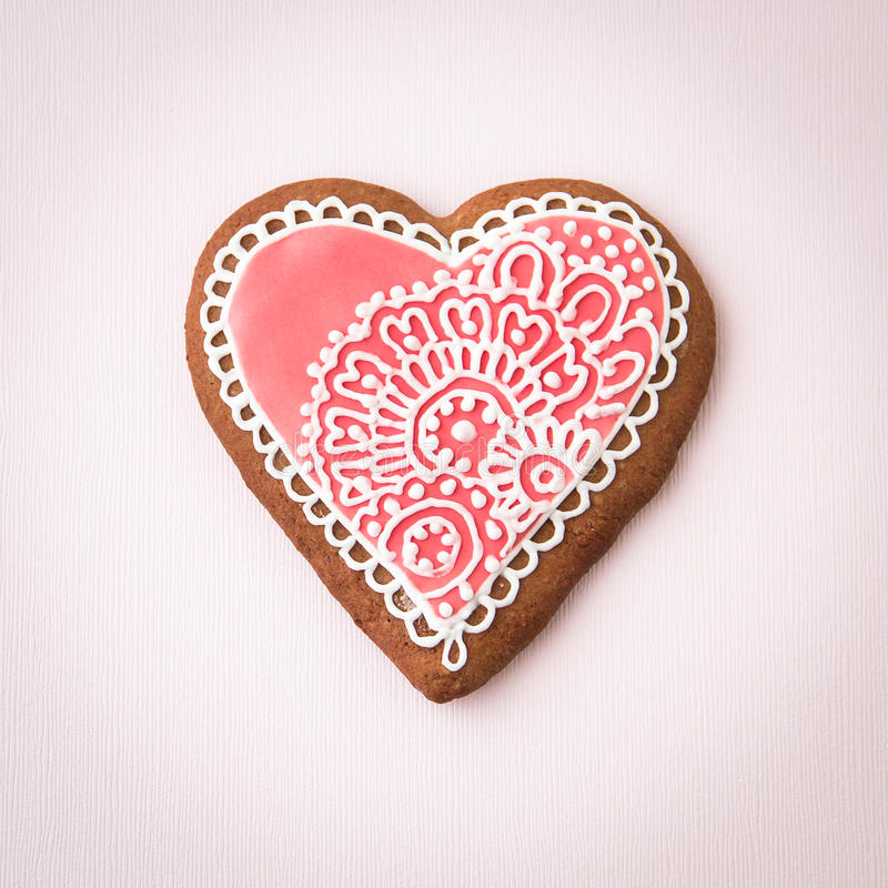 Home-baked and decorated heart shaped cookie royalty free stock image