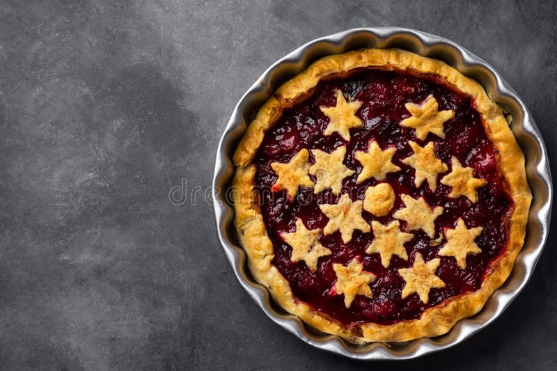 Home baked puff pastry Christmas New years pie torte with plum cinnamon jam filling decorated with stars stock image