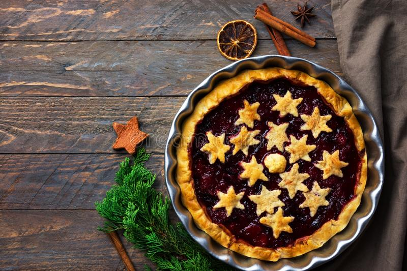 Home baked puff pastry Christmas New years pie torte with plum cinnamon jam filling decorated with stars fir tree royalty free stock photography
