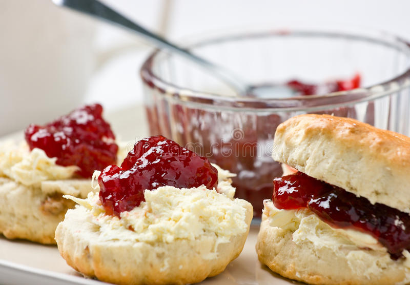Home baked scones with strawberry jam and clotted royalty free stock photography