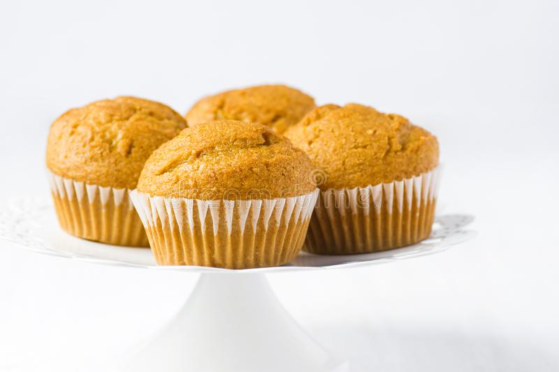 Home baked whole wheat bran pumpkin muffins on white cake stand. Breakfast Morning Healthy Pastry Autumn Baking Concept stock image