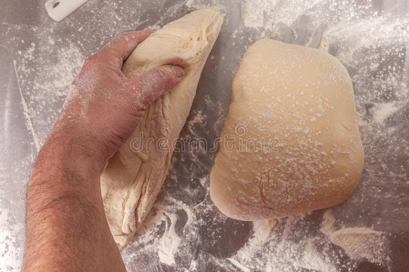 Hand made bread dough being prepared stock image