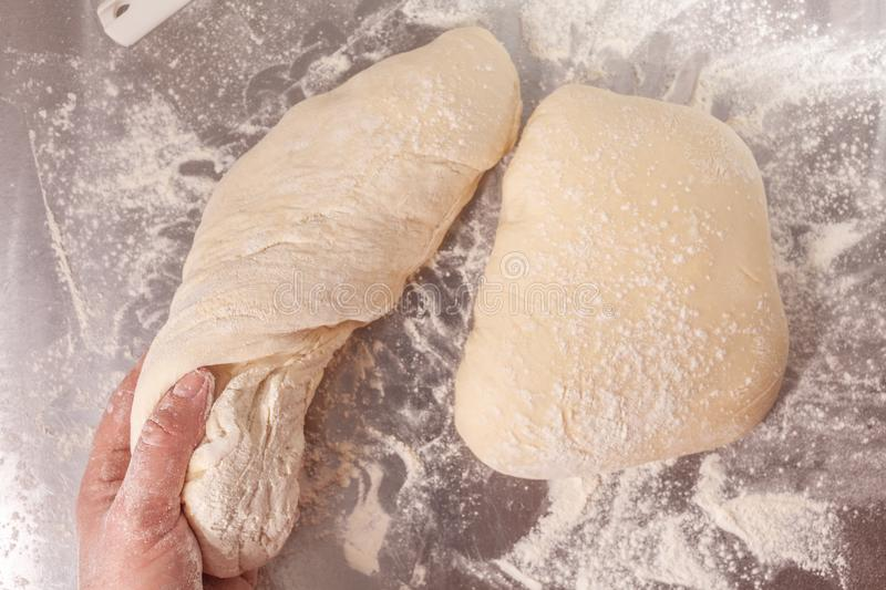 Hand made bread dough being prepared stock photo