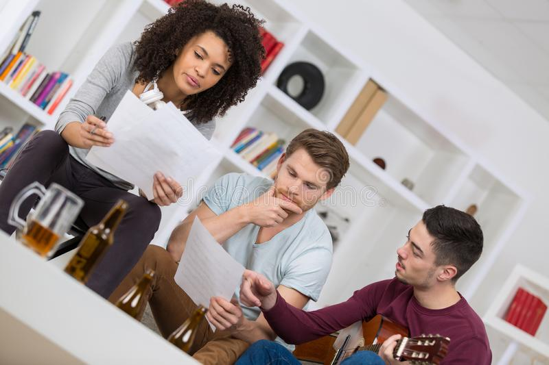 Home band learning new song together royalty free stock images