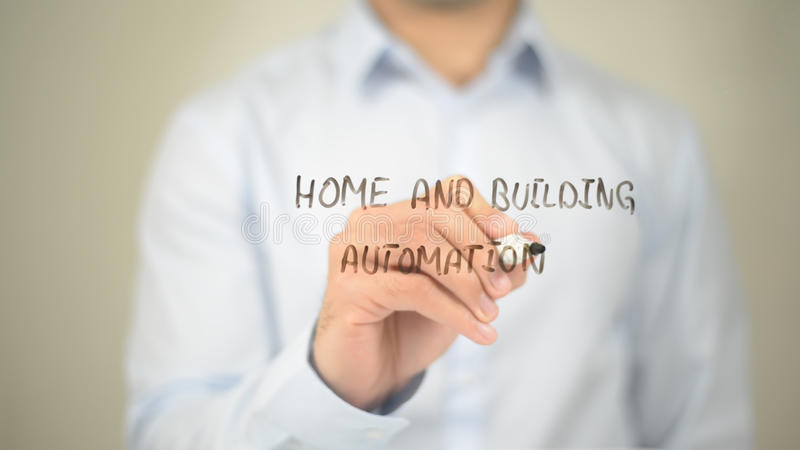 Home and Building Automation , Man writing on transparent screen. High quality royalty free stock image