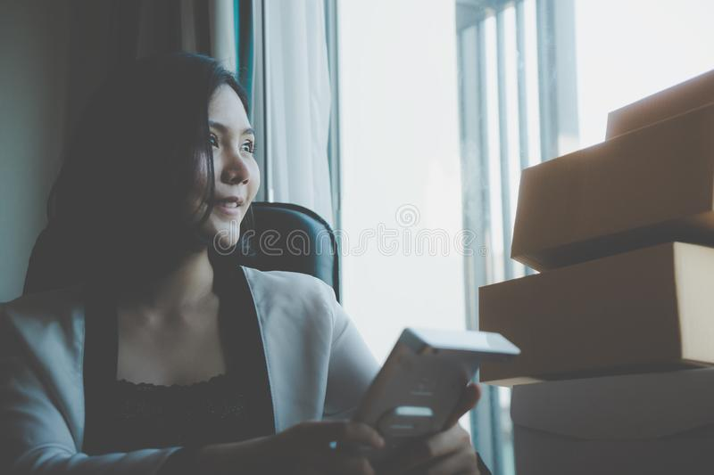 Home business woman is looking out the windows royalty free stock photography