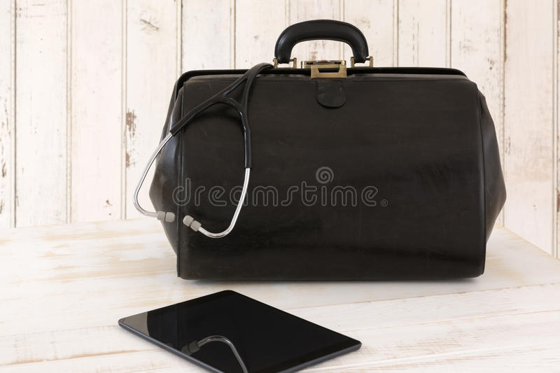 Home call, doctor's bag with stethoscope and Tablet royalty free stock image