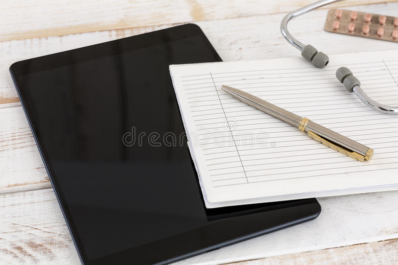 Home call, doctor's visit, electronic documentation, written documentation, tablet with organizer and stethoscope stock image