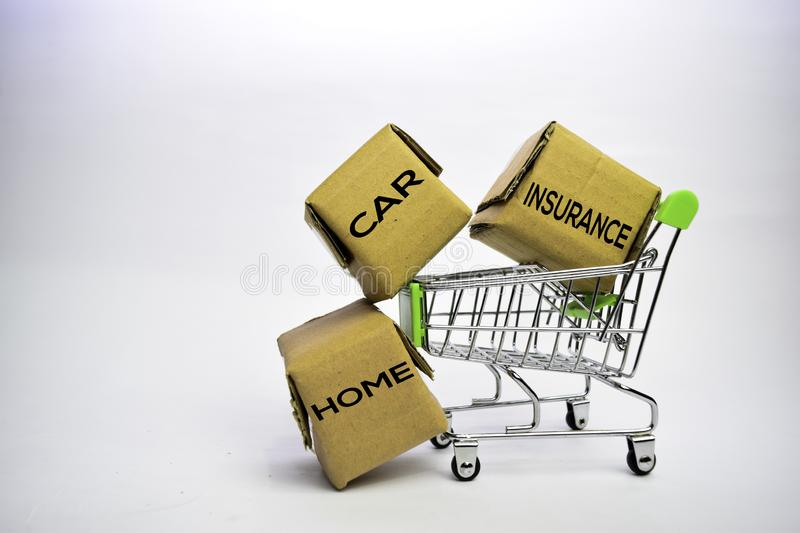 Home. Car. Insurance Text in small boxes and shopping cart. Concepts about online shopping. Isolated on white background royalty free stock images