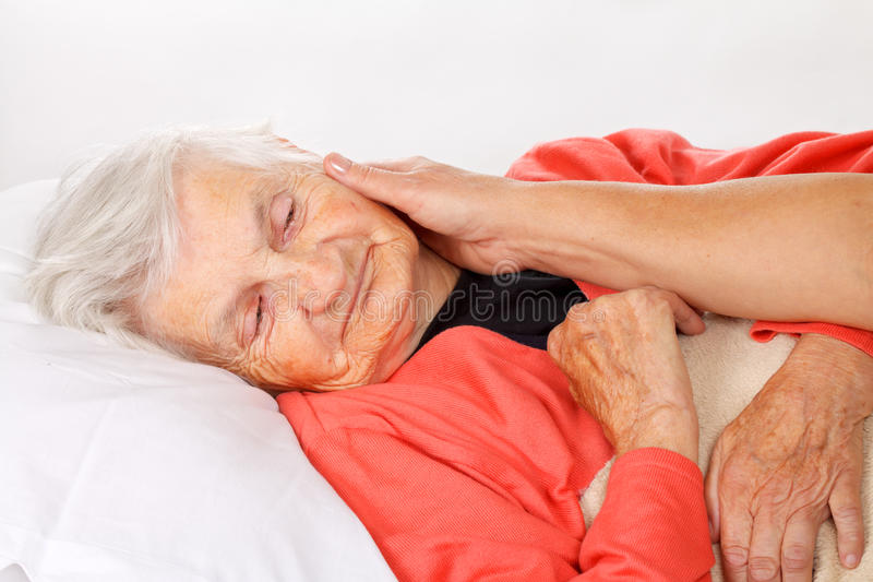 Home care. Seniors woman with her caregiver at home stock photo