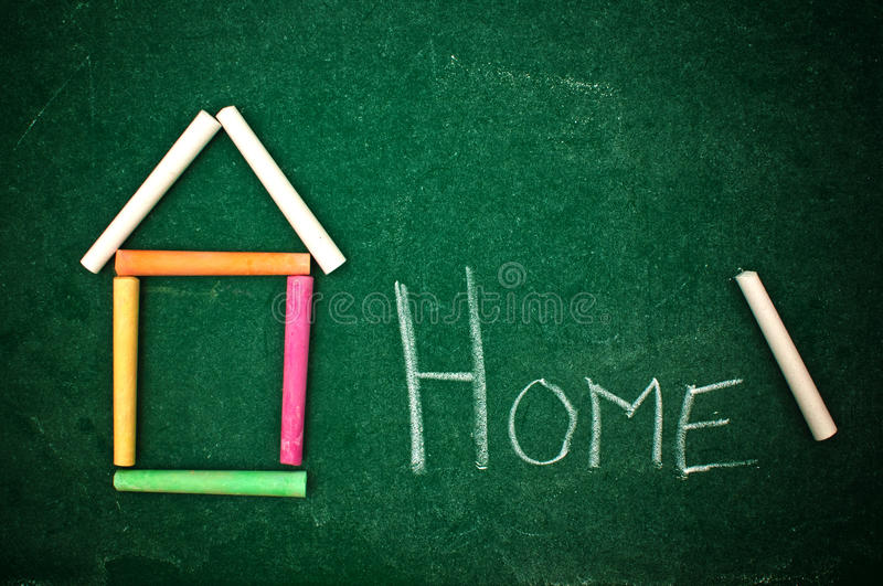 Home on chalkboard stock image