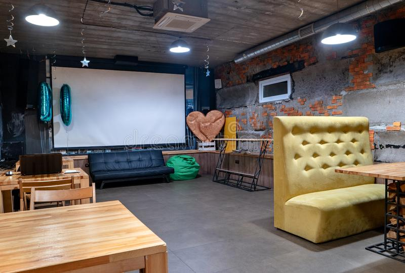 Home cinema in cafe stock photography