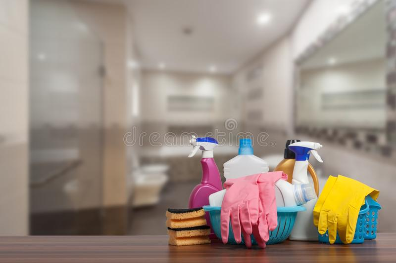 Home cleaning service concept with supplies. Close up of cleaning supplies in front of bathroom. Home cleaning service concept with supplies. Cleaning supplies stock images