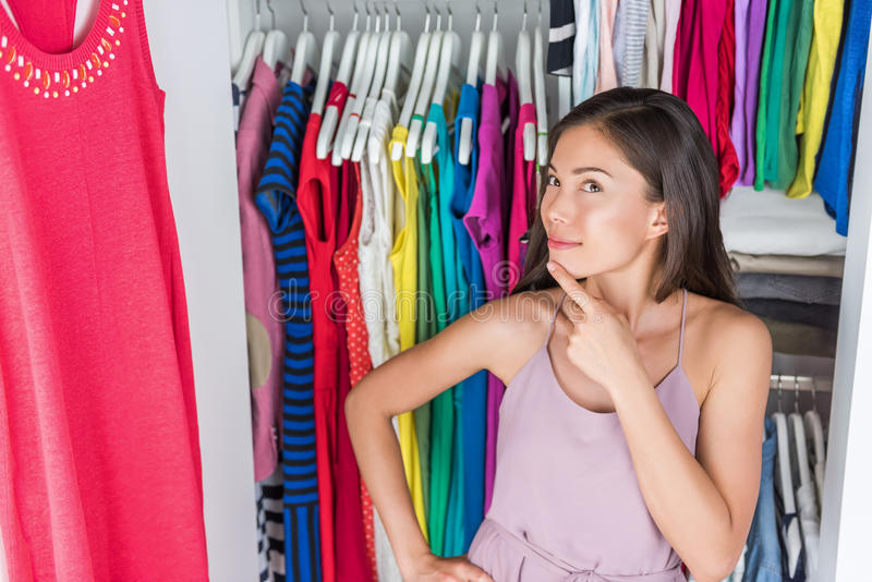Home closet clothing rack girl thinking of outfit stock images