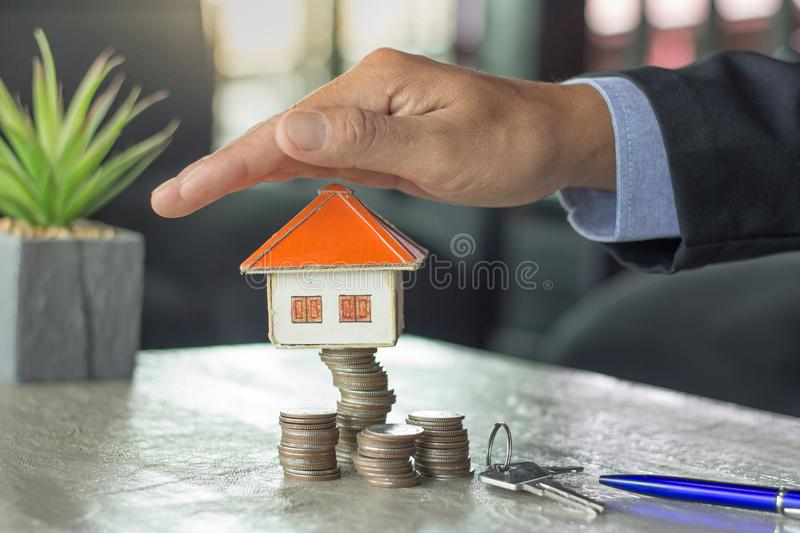 Home on coins stack, Property investment and house mortgage financial. Risk management concept. royalty free stock photo