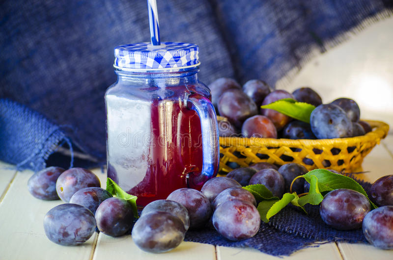 Home compote of plum. Home compote of ripe plum fruit on a table royalty free stock images