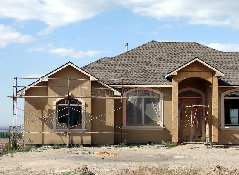 Home Construction. A new home nears completion stock photos