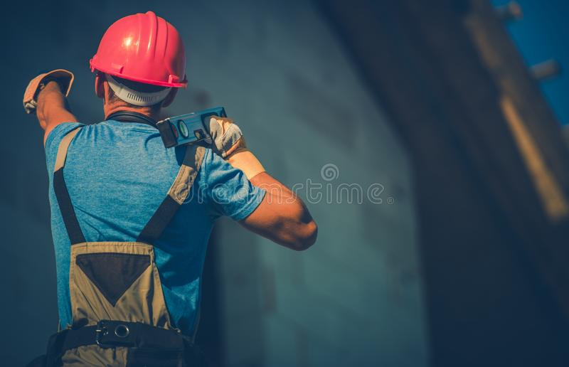Home Construction Work. Caucasian Contractor with Level Tool. Residential Developing royalty free stock photo