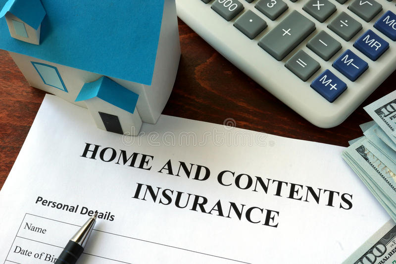 Home and contents insurance. Form and dollars on the table royalty free stock photography