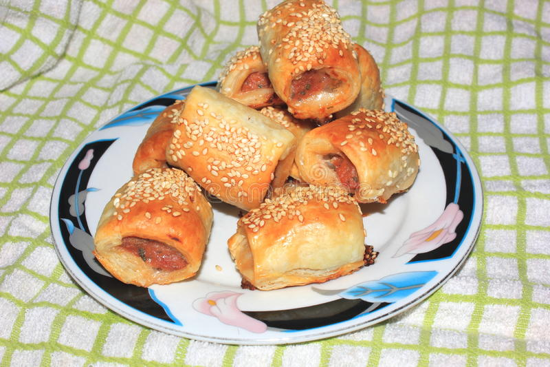 Home cooked sausage rolls stock photography