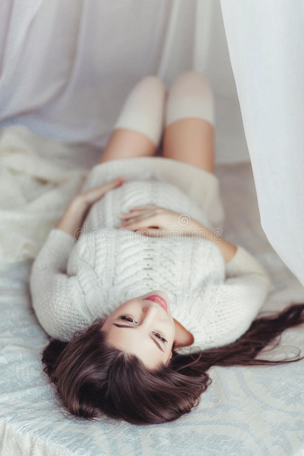 Home cozy portrait of pregnant woman resting on sofa royalty free stock images