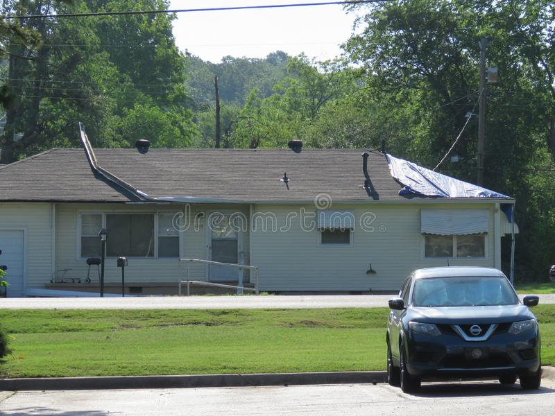 Home damage following tornado in Fort Smith, AR stock images