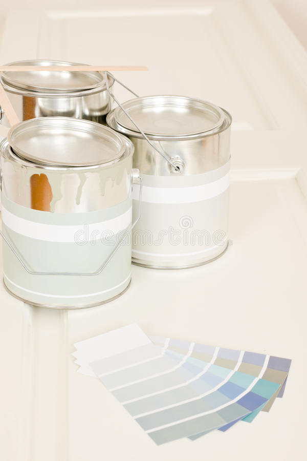 Home decorating paint can color swatches. Home decorating paint can and color swatches on white desk royalty free stock images
