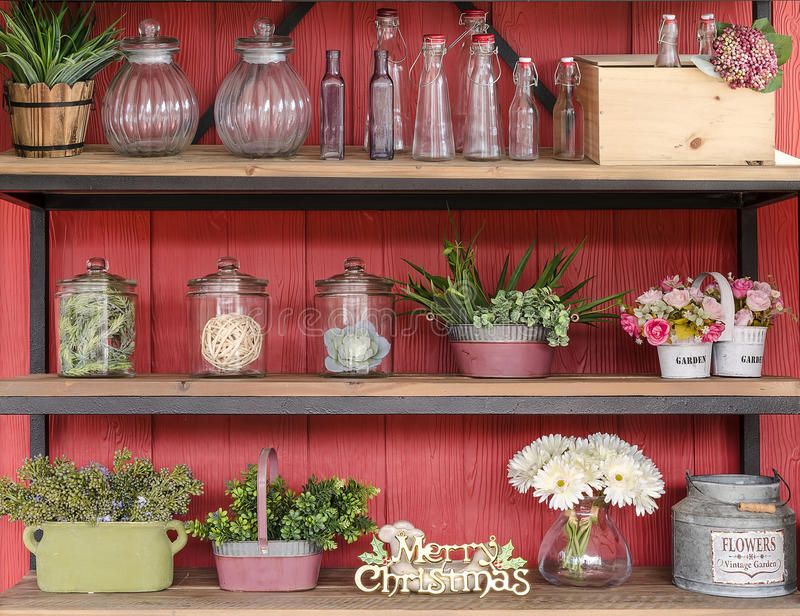 Home decoration. On shelves and red wooden background stock images