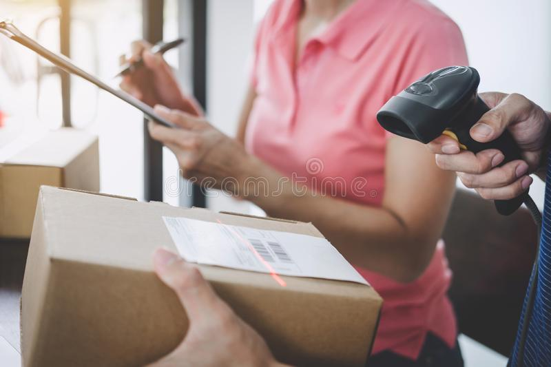 Home delivery service and working service mind, deliveryman working barcode scan checking order to confirm sending customer in royalty free stock images