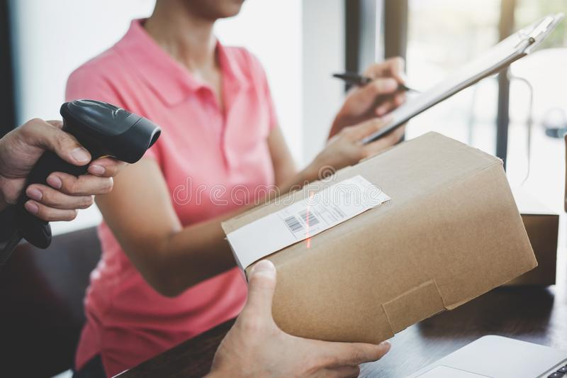 Home delivery service and working service mind, deliveryman working barcode scan checking order to confirm sending customer in. Post office royalty free stock photo