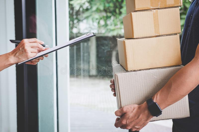 Home delivery service and working with service mind, Woman customer signing and receiving a cardboard boxes parcel from stock photos