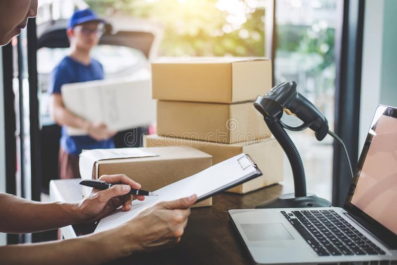 Home delivery service and working service mind, Woman working checking order to confirm before sending customer in post office.  royalty free stock photo