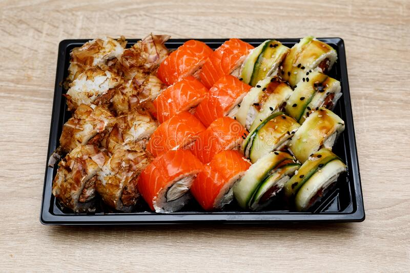 Home delivery of sushi set in a plastic box.  stock photo