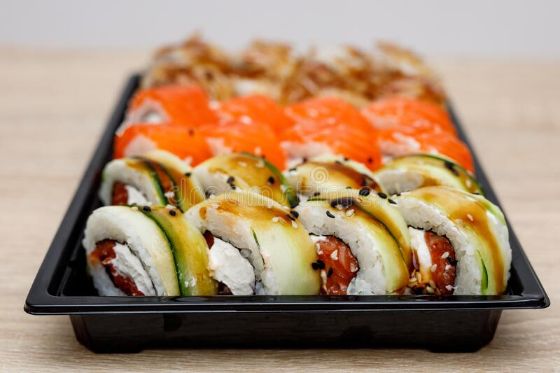 Home delivery of sushi set in a plastic box.  royalty free stock photography