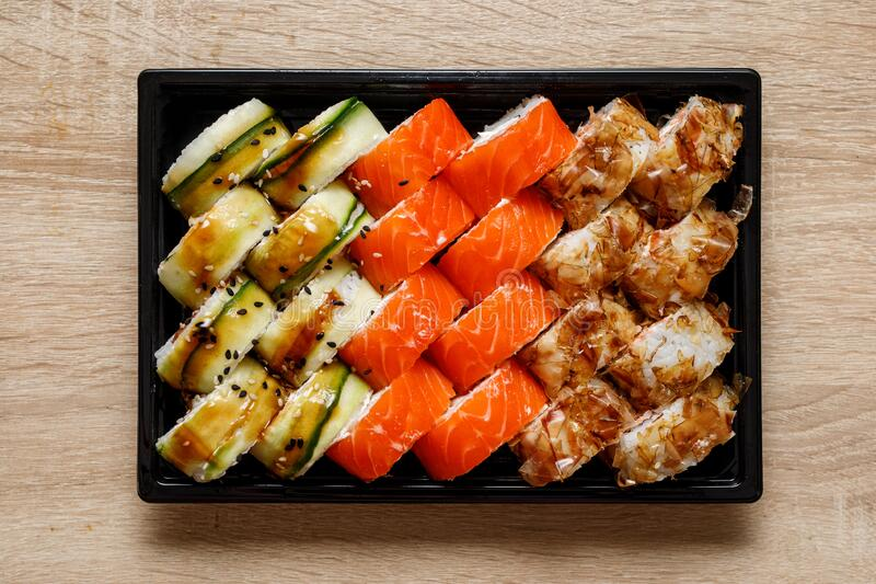 Home delivery of sushi set in a plastic box.  stock photos
